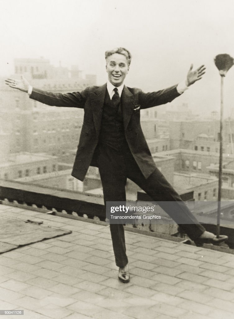Charlie Chaplin Clowning On A Rooftop : News Photo