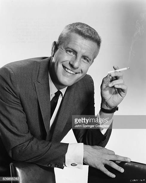 Actor and Comedian Jerry Van Dyke Holding a Cigarette