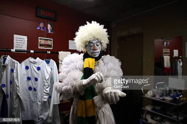 Actor and comedian Kat B playing the Snowman adjusts his costume backstage during a performace of Jack and the Beanstalk at Hackney Empire on...