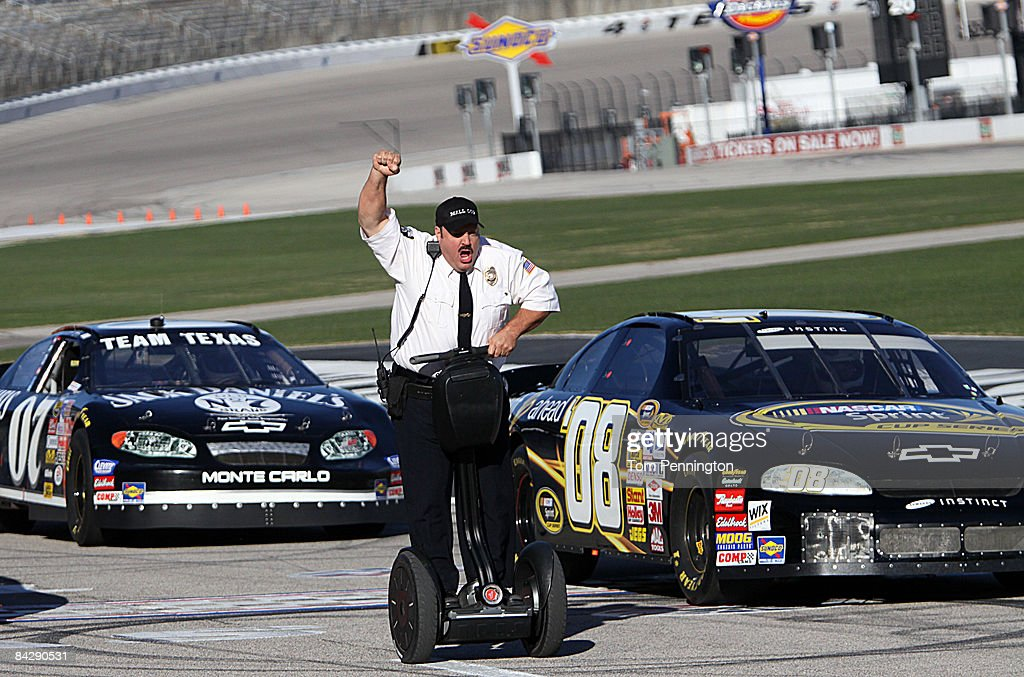 WORTH, TX JANUARY 14 - Actor and comedian Kevin James celebrates after racing NASCAR stock cars with his Segway to promote the release of his new movie, 'Paul Blart: Mall Cop' at Texas Motor Speedway in Fort Worth, Texas.