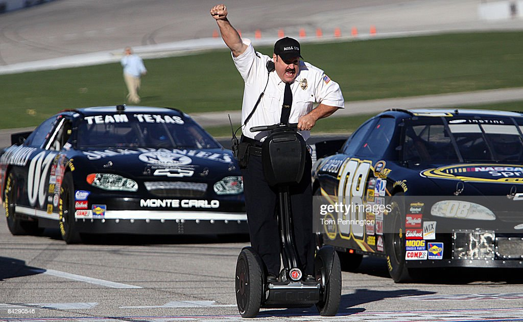 WORTH, TX JANUARY 14 - Actor and comedian Kevin James celebrates while racing NASCAR stock cars with his Segway to promote the release of his new movie, 'Paul Blart: Mall Cop' at Texas Motor Speedway in Fort Worth, Texas.