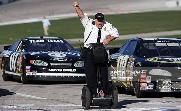 WORTH TX JANUARY 14 Actor and comedian Kevin James celebrates while racing NASCAR stock cars with his Segway to promote the release of his new movie...