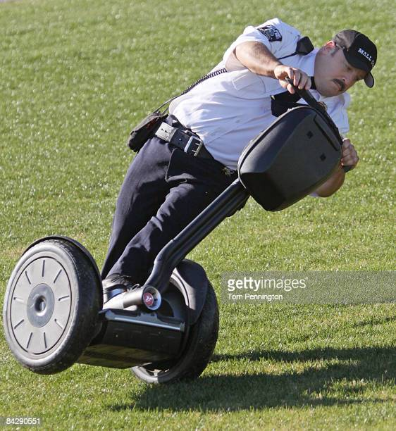 Actor and comedian Kevin James skids out in the infield grass while celebrating after racing NASCAR stock cars with his Segway to promote the release...