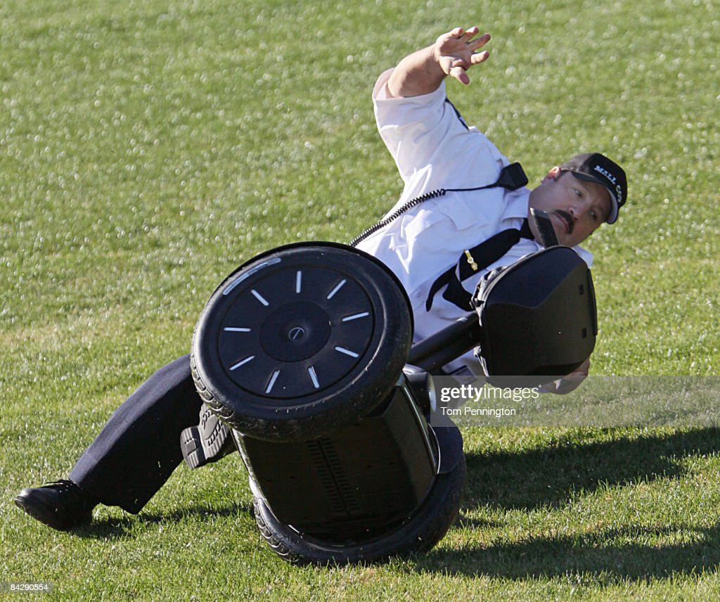 WORTH, TX JANUARY 14 - Actor and comedian Kevin James skids out in the infield grass while celebrating after racing NASCAR stock cars with his Segway to promote the release of his new movie, 'Paul Blart: Mall Cop' at Texas Motor Speedway in Fort Worth, Texas. James was not injured in the fall.