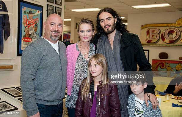 Actor and comedian Russell Brand and talent agent Adam Venit his wife Trina and their children Olivia and Matthew attend the Yahoo Sports Presents A...
