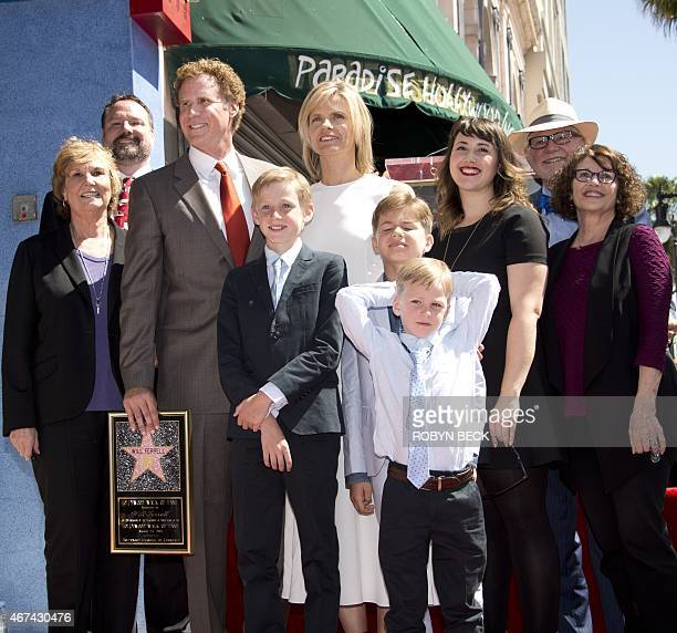 Actor and comedian Will Ferrell stands on his star on the Hollywood Walk of Fame with members of his family including his wife Viveca Paulinand three...