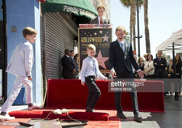 Actor and comedian Will Ferrell tells his children Magnus Mattias and Axel to walk around his new star on the Hollywood Walk of Fame at a ceremony to...