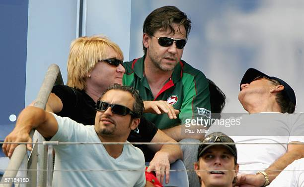 Actor and coowner of the South Sydney Rabbitohs Rugby League team Russell Crowe chats with friends at the round three NRL match between the South...