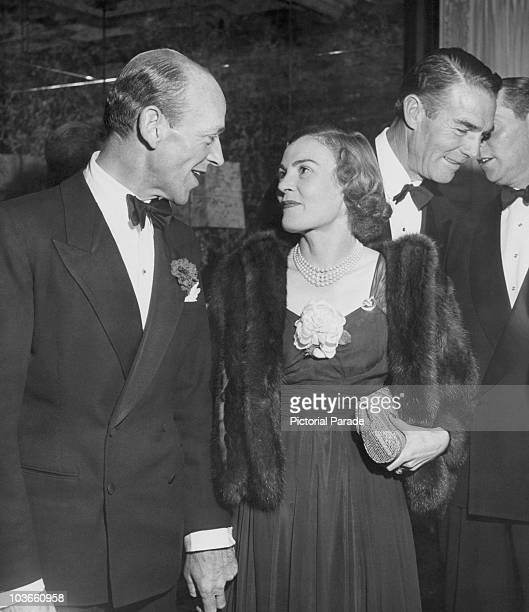 Actor and dancer Fred Astaire and his wife Phyllis Potter dressed in evening wear attending a party USA circa 1950 Astaire is wearing a tuxedo and...