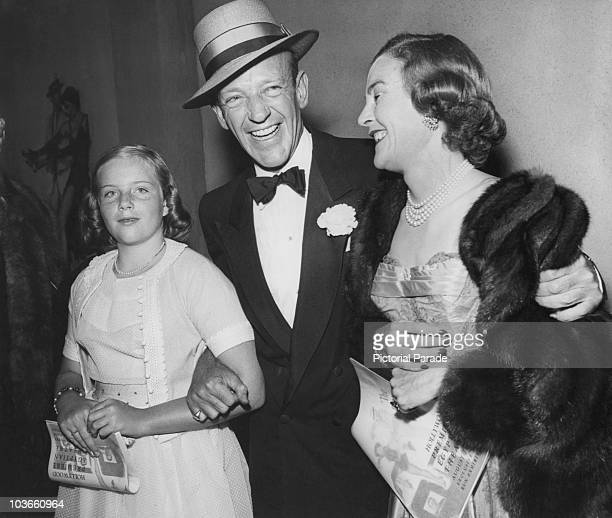 Actor and dancer Fred Astaire and his wife Phyllis Potter with their daughter Ava Astaire dressed in evening wear attending a film premiere at...