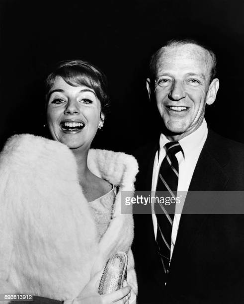 US actor and dancer Fred Astaire arrives with his daughter Ava for the premiere of the film 'On the beach' directed by Stanley Kramer on December 28...
