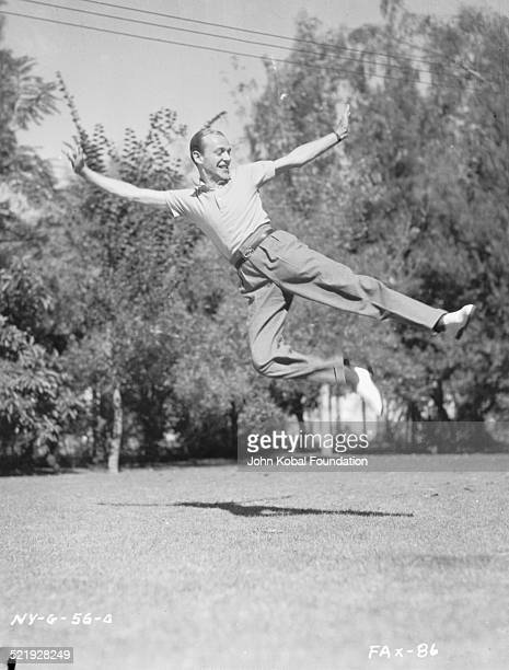 Actor and dancer Fred Astaire for RKO Pictures practicing choreography outdoors circa 19401950