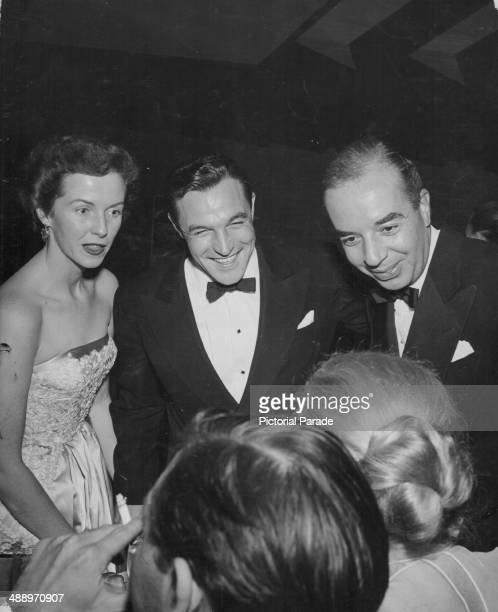 Actor and dancer Gene Kelly with his wife Betsy Blair and director Vincente Minnelli attending a Hollywood Party California March 1953