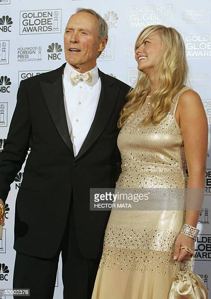 US actor and director Clint Eastwood and daughter Kathryn pose in the press room at the 62nd annual Golden Globe Awards show in Beverly Hills CA 16...