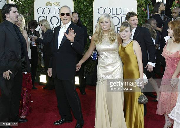 US actor and director Clint Eastwood and daughters Kathryn and francesca arrive on the red carpet for the 62nd annual Golden Globe Awards show 16...