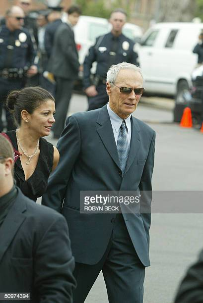 Actor and director Clint Eastwood arrives with his wife Dina Ruiz outside the First AME Church for the funeral of music legend Ray Charles 18 June...