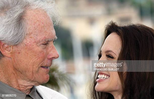 US actor and director Clint Eastwood poses with actress Angelina Jolie during a photocall for his film 'The Exchange' at the 61st Cannes...