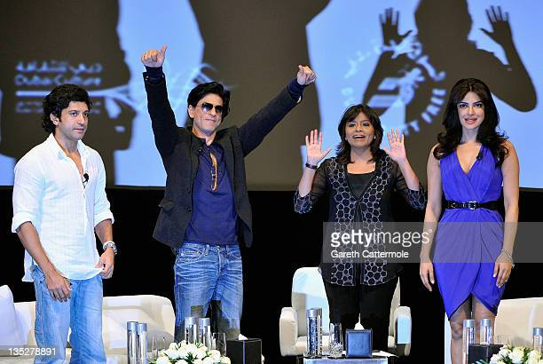 Actor and director Farhan Akhtar actor Shah Rukh Khan and actress Priyanka Chopra onstage ahead of an QA session on day two of the 8th Annual Dubai...