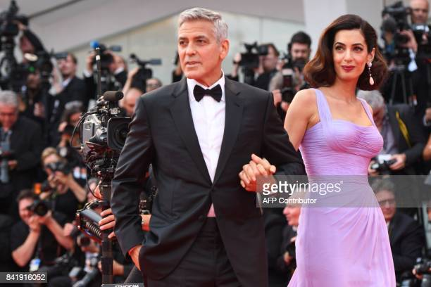 US actor and director George Clooney and his wife Amal attend the premiere of the movie Suburbicon presented out of competition at the 74th Venice...