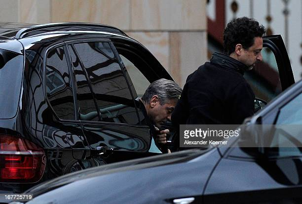 Actor and director George Clooney and producer Grant Heslov are seen entering the hotel through the backdoor on April 28 2013 in Ilsenburg Germany...
