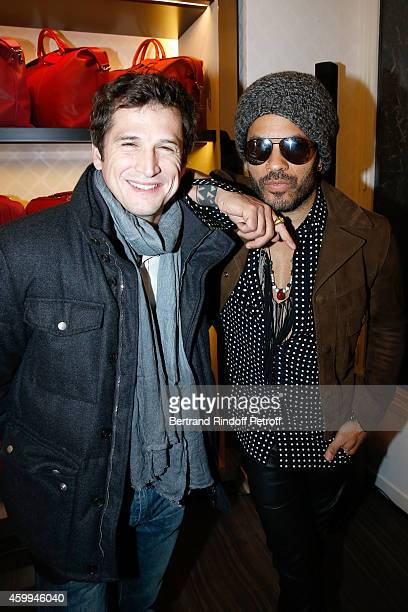Actor and Director Guillaume Canet and singer Lenny Kravitz attend the Longchamp Elysees 'Lights On Party' Boutique Launch on December 4 2014 in...