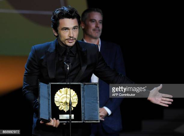 US actor and director James Franco holds the 'Concha de Oro' best film award for the film 'The Disaster artist' during the 65th San Sebastian Film...