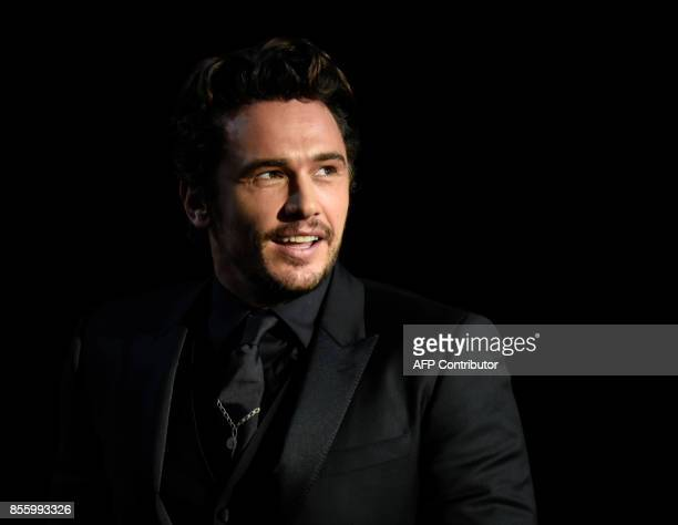 US actor and director James Franco smiles after receiving the 'Concha de Oro' best film award for the film 'The Disaster artist' during the 65th San...