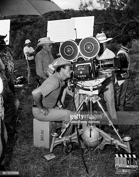 Actor and director John Wayne behind the camera during the filming of 'The Alamo' in Texas in 1960