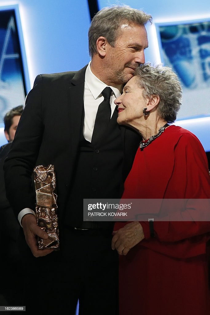 US actor and director Kevin Costner (L) hugs French actress Emmanuelle Riva as they pose with their trophies at the end of the 38th Cesar Awards ceremony on February 22, 2013 at the Chatelet theatre in Paris.