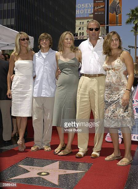 Actor and director Kevin Costner poses with fiancee Christine Baumgartner son Joe and daughters Annie and Lily at ceremony honoring Costner with a...