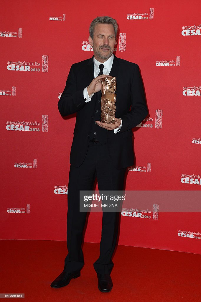 US actor and director Kevin Costner poses with his trophy after receiving a lifetime achievement award during a photocall at the 38th Cesar Awards ceremony on February 22, 2013 at the Chatelet theatre in Paris.