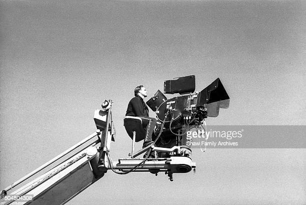 Actor and Director Marlon Brando sits on a film crane behind a camera in 1959 during the filming of 'OneEyed Jacks' in Monterey California