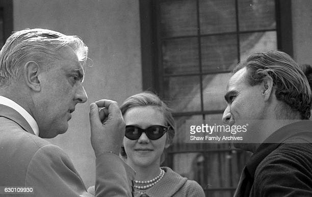 Actor and director Marlon Brando talks to French actor and director Jacques Tati who paid Brando a visit on the set of 'OneEyed Jacks' circa 1959 in...