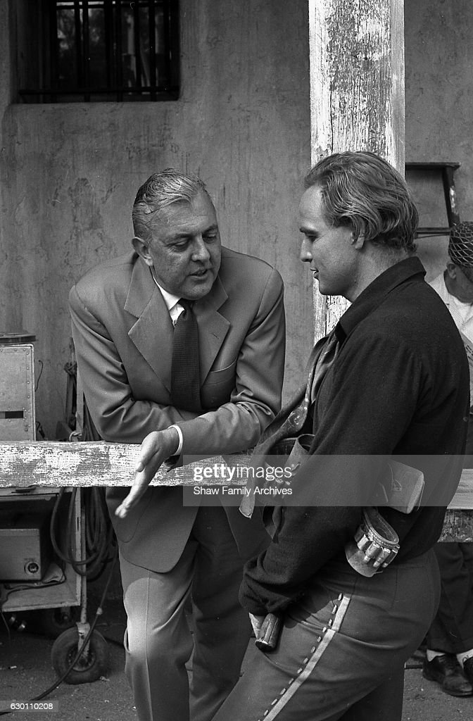 Actor and director Marlon Brando talks to French actor and director Jacques Tati, who paid Brando a visit on the set of 'One-Eyed Jacks' circa 1959 in Los Angeles, California.