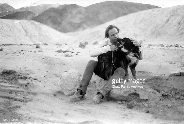 Actor and Director Marlon Brando with a dog circa 1959 during the filming of 'OneEyed Jacks' in Death Valley California