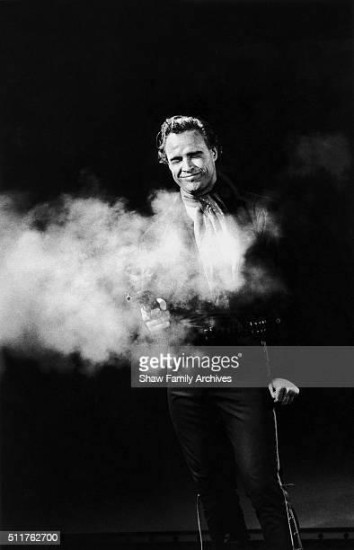 Actor and director Marlon Brando with a smoking gun circa 1959 during the filming of 'OneEyed Jacks' in Los Angeles California