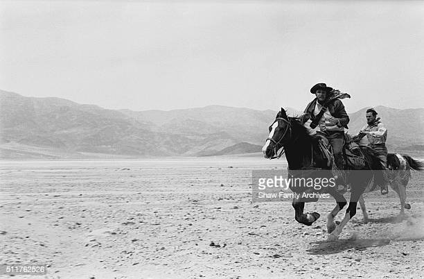 Actor and director Marlon Brando with costar Karl Malden galloping on horseback during the filming of 'OneEyed Jacks' circa 1959 in Death Valley...
