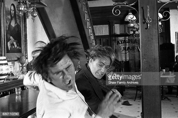 Actor and director Marlon Brando with Timothy Carey circa 1959 in a bar fight scene during the making of 'OneEyed Jacks' in Los Angeles California