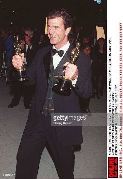 Actor and director Mel Gibson holds the two Academy Award statuettes that he and his film 'Braveheart' received for Best Picture and Best Director as...