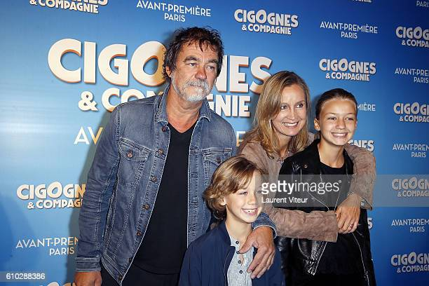 Actor and Director Olivier Marchal his wife Actress Catherine Marchal them son Basile and them daughter Ninon attend the 'Cigognes Compagnie' Paris...
