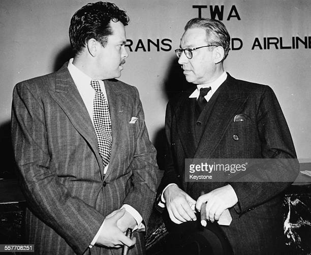 Actor and director Orson Welles talking to producer Sir Alexander Korda at the TWA Terminal of La Guardia Field New York circa 1955