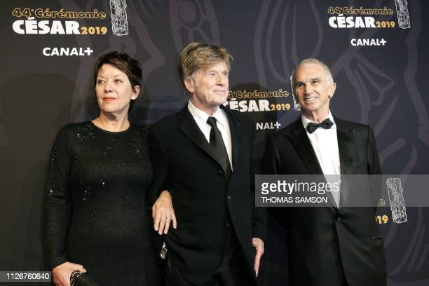 US actor and director Robert Redford his wife Sibylle Szaggars and FrenchArmenian film producer and Cesar Academy president Alain Terzian pose upon...
