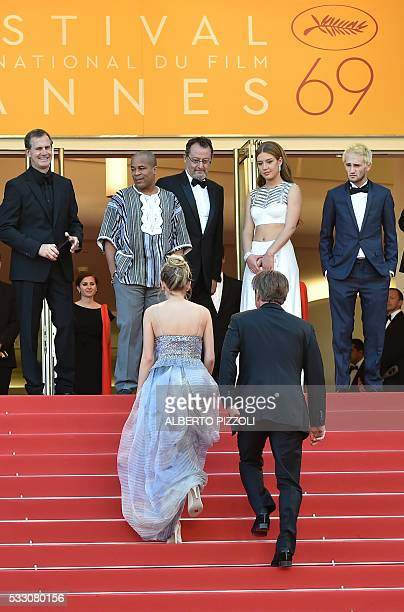 US actor and director Sean Penn and his daughter Dylan Frances Penn walk up the steps to join US producer Matt Palmieri US actor Zubin Cooper French...
