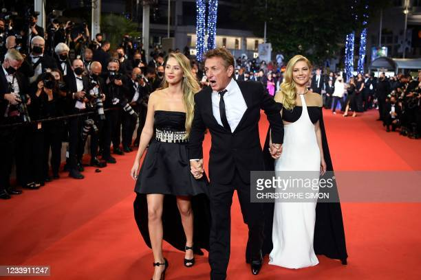 Actor and director Sean Penn arrives with his daughter US actress Dylan Penn and Canadian actress Katheryn Winnick for the screening of the film...