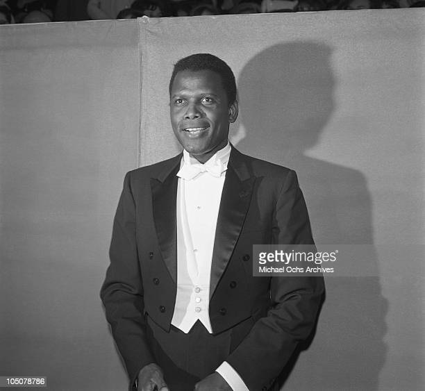 Actor and director Sidney Poitier arrives at the 36th Acadamy Awards outside the Santa Monica Civic Auditorium on April 13 1964 in Santa Monica...