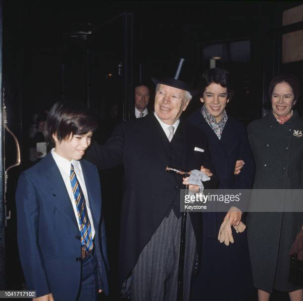 Actor and director Sir Charlie Chaplin with his family in London where he is receiving a KBE 4th March 1975 From left to right his son Christopher...