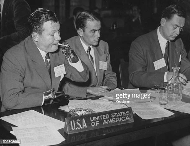 Actor and double amputee Harold Russell smoking a cigarette as he ad the other US delegates attend the World Conference of War Invalids Paris...