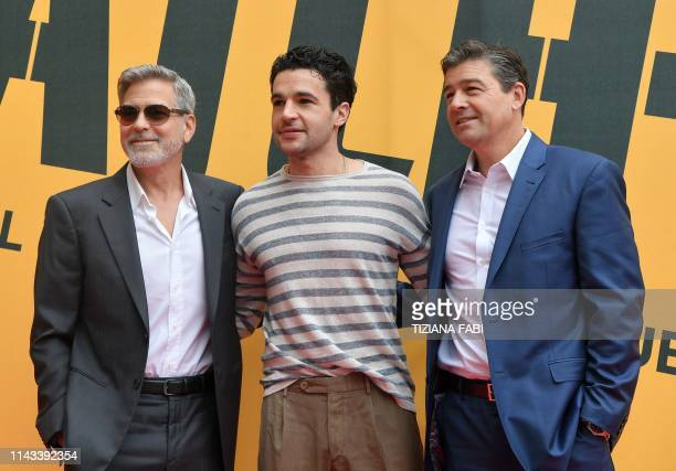 US actor and film director George Clooney poses with US actors Christopher Abbott and Kyle Chandler during a photocall of the Catch22 TV show on May...