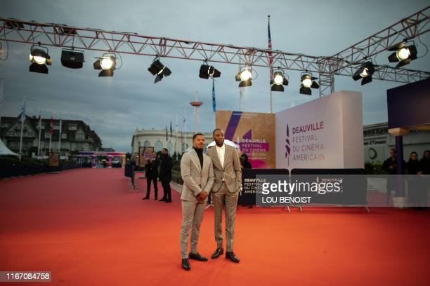 Actor and film director Nate Parker poses with French singer Abd al Malik on the red carpet of the 45th Deauville US Film Festival, in Deauville on...