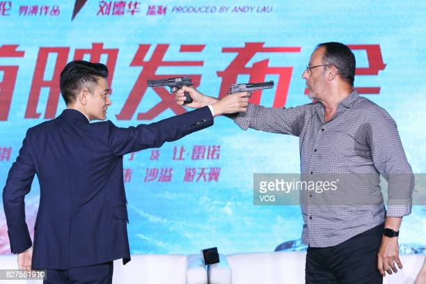 Actor and film producer Andy Lau actor Jean Reno attend the premiere of director Stephen Fung's film The Adventurers on August 8 2017 in Beijing China